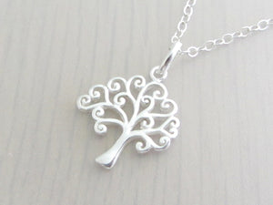silver curly tree charm on a silver chain