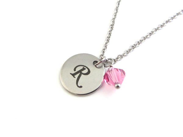 laser engraved capital initial letter disc charm and a pink crystal charm on a stainless steel chain