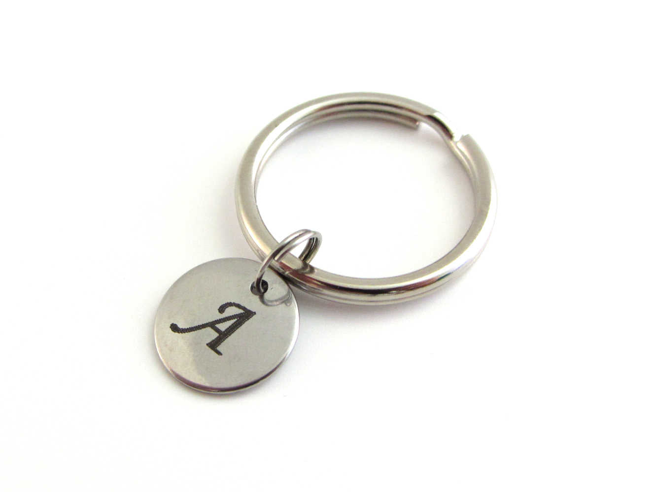 stainless steel laser engraved capital initial letter disc charm on a keyring