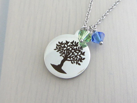 stainless steel laser engraved tree charm with coloured crystals on a stainless steel chain