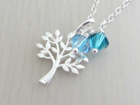 silver tree charm with coloured crystals on a silver chain