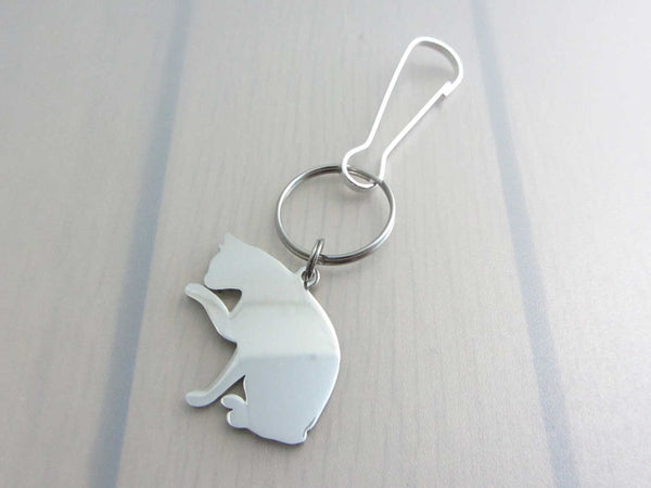 stainless steel pet cat sitting licking paw charm on a on a bag charm with snap clip hook