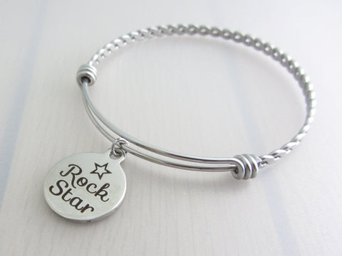 "stainless steel laser engraved ""rock star"" with star disc charm on a bangle with braided twist pattern"