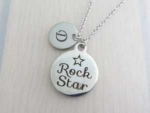 "laser engraved capital initial letter disc charm and laser engraved ""rock star"" with star charm on a stainless steel chain"