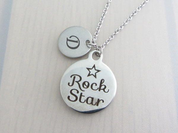 "laser engraved capital initial letter disc charm and laser engraved ""rock star"" with star disc charm on a stainless steel chain"