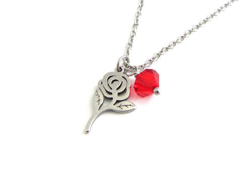 rose flower charm and a red crystal charm on a stainless steel chain