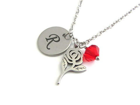 laser engraved capital initial letter disc charm, rose flower charm and a red crystal charm on a stainless steel chain