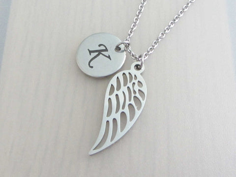 laser engraved capital initial letter disc charm and single angel wing charm on a stainless steel chain