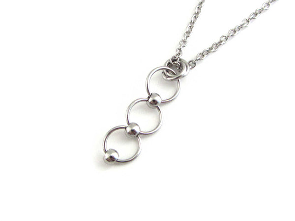 beaded linked circle rings chainmaille pendant on a stainless steel chain