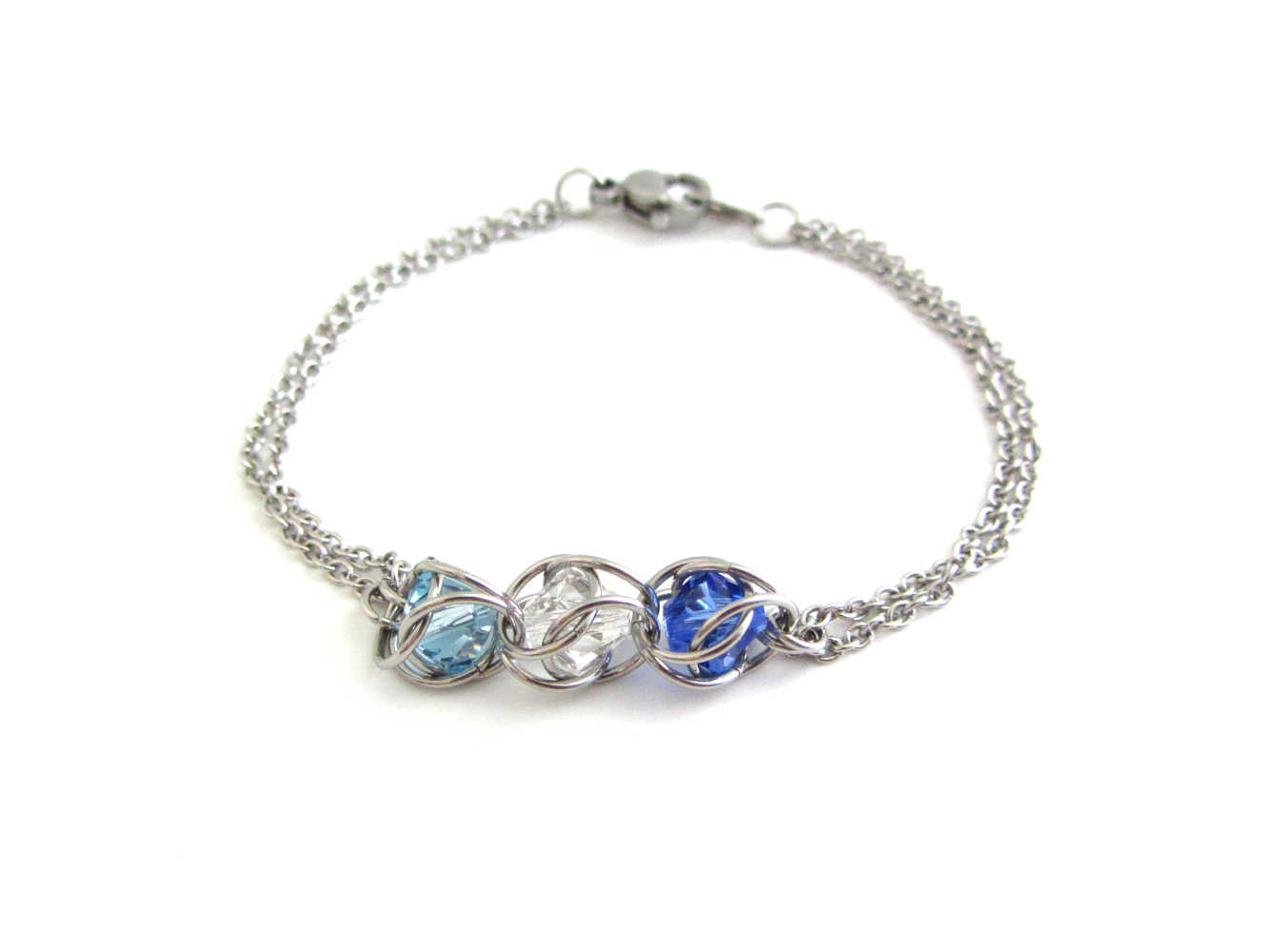 captured light blue, clear and dark blue crystal beads chainmaille bracelet