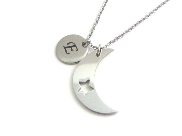 laser engraved capital initial letter disc charm and crescent moon charm with cut out star on a stainless steel chain