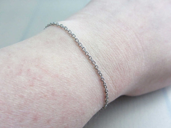 dainty stainless steel chain bracelet on wrist
