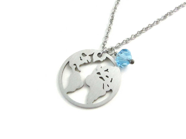 world globe earth map charm and a light blue crystal charm on a stainless steel chain