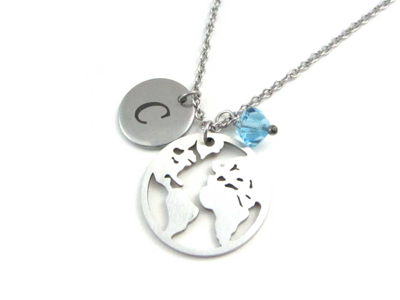 laser engraved capital initial letter disc charm, world globe earth map charm and a light blue crystal charm on a stainless steel chain
