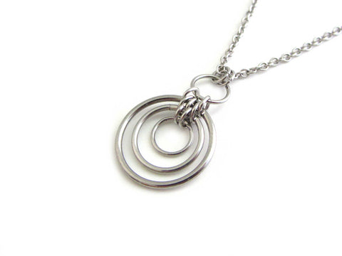 floating linked circle rings chainmaille pendant on a stainless steel chain