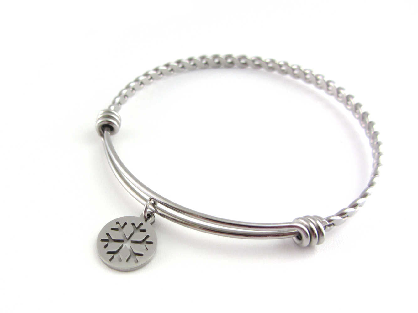 stainless steel snowflake charm on a bangle with braided twist pattern