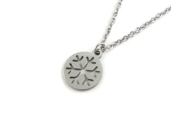 cut out snowflake charm on a stainless steel chain
