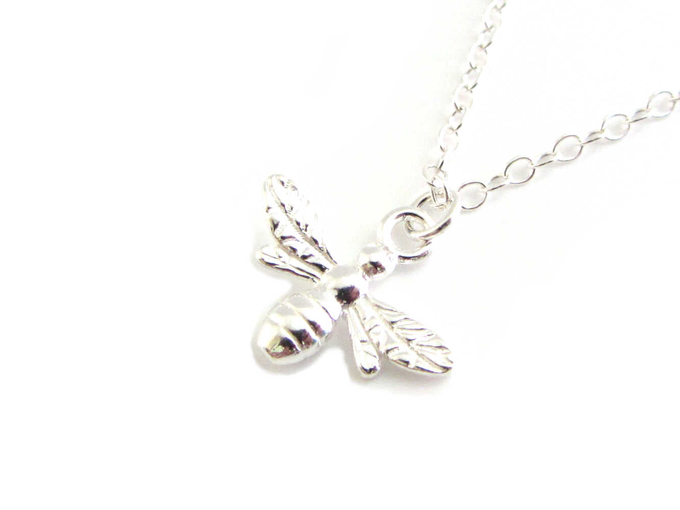 silver bee charm on a silver chain