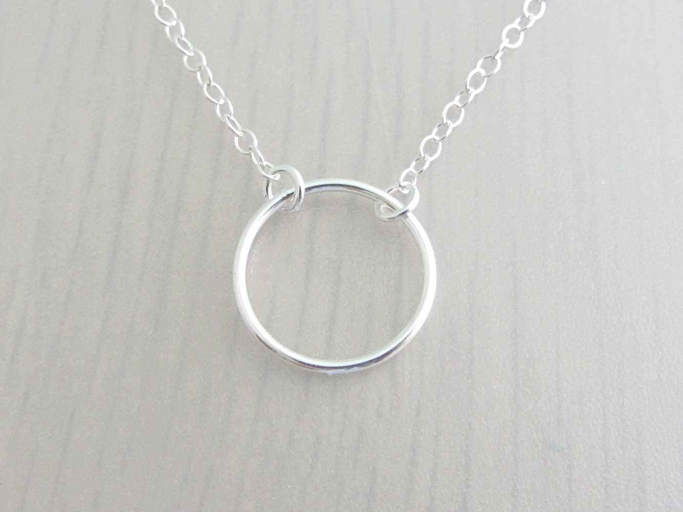 silver circle ring on a silver chain