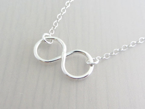 silver infinity charm on a silver chain