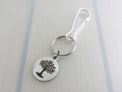 laser engraved tree charm on a bag charm