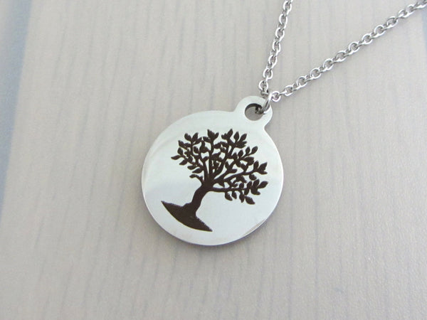 stainless steel laser engraved tree charm on a stainless steel chain