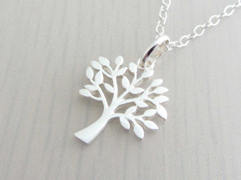 silver tree charm on a silver chain