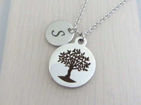 laser engraved capital initial letter disc charm and laser engraved tree charm on a stainless steel chain