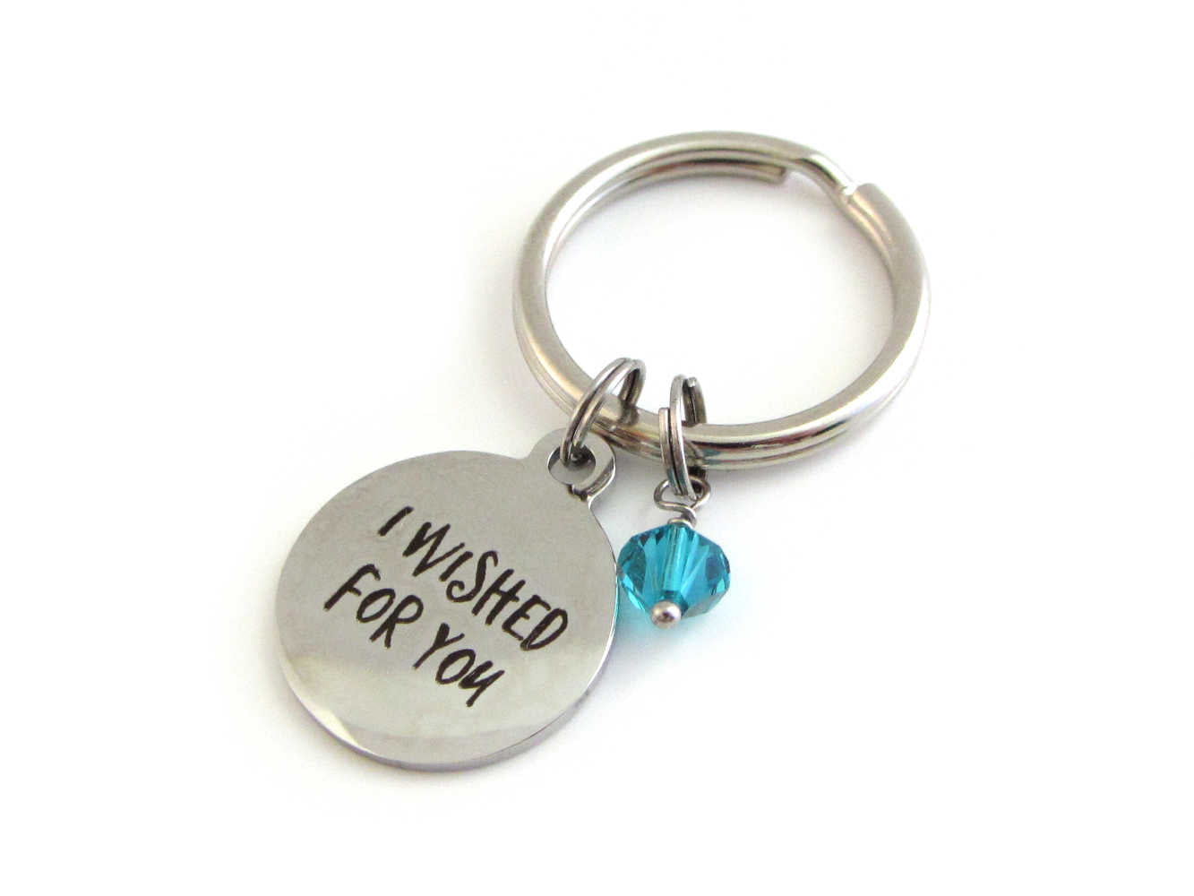 "laser engraved ""I wished for you"" charm and a blue/green crystal charm on a keyring"