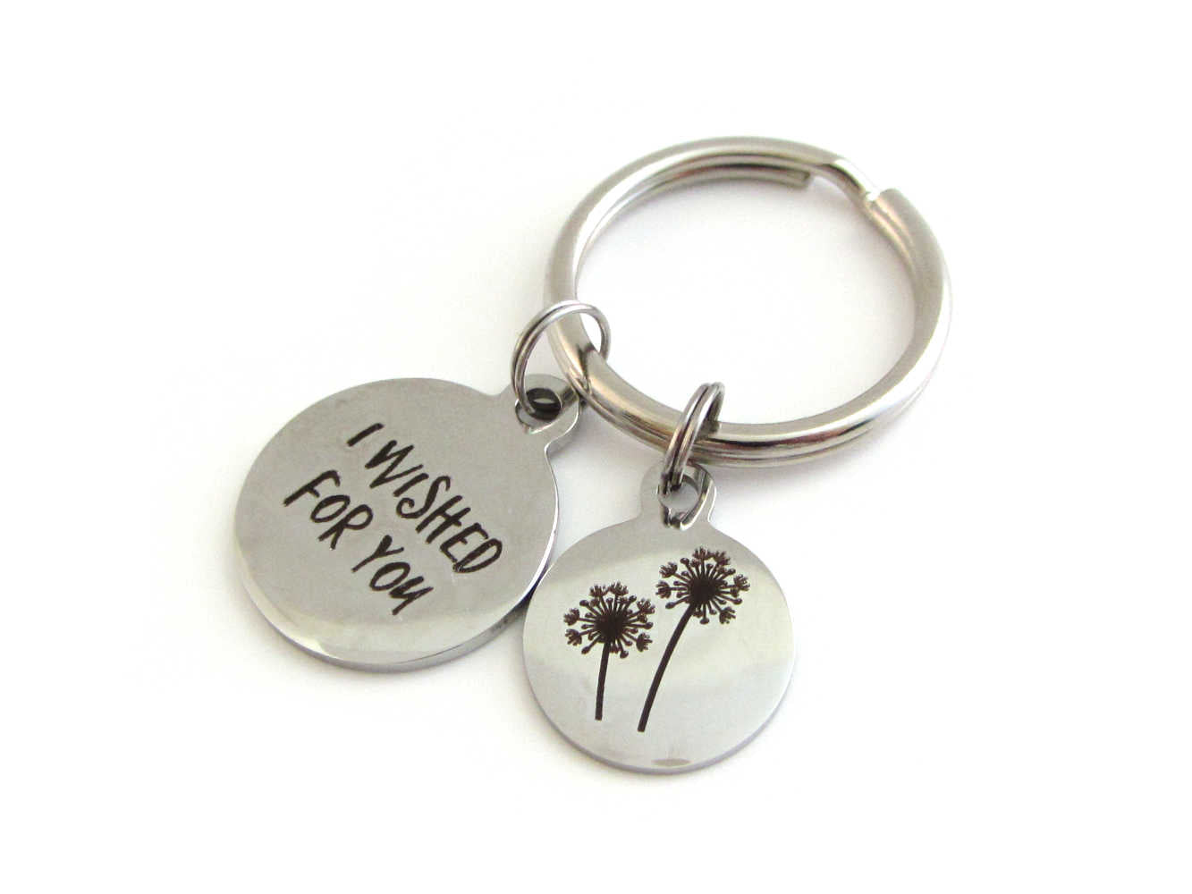 "laser engraved ""I wished for you"" charm and a laser engraved dandelion flowers charm on a keyring"