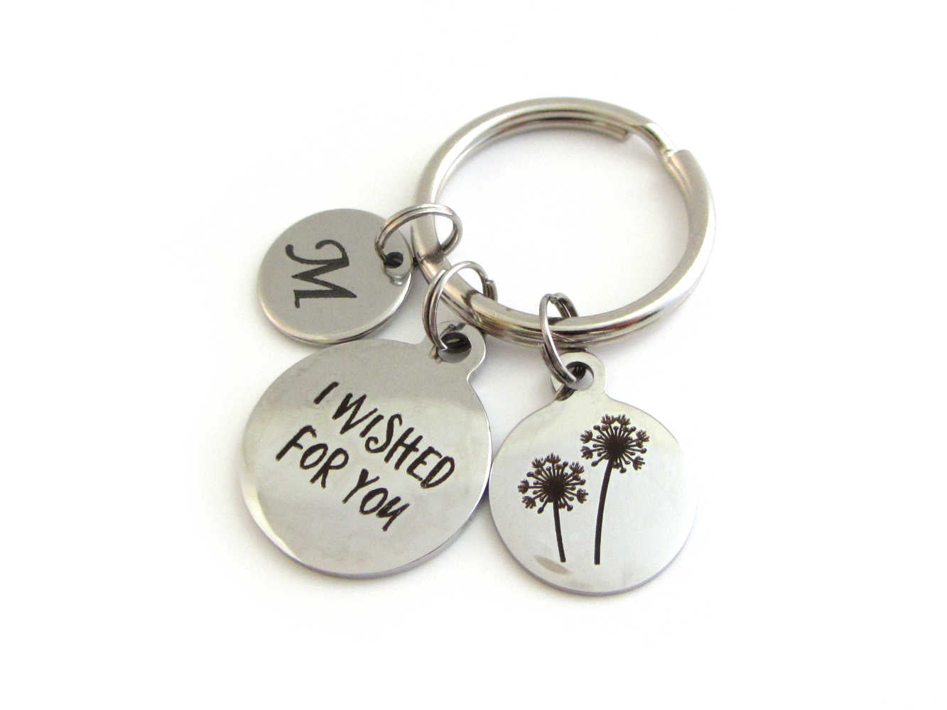 "laser engraved capital initial letter disc charm, a laser engraved ""I wished for you"" charm and a laser engraved dandelion flowers charm on a keyring"