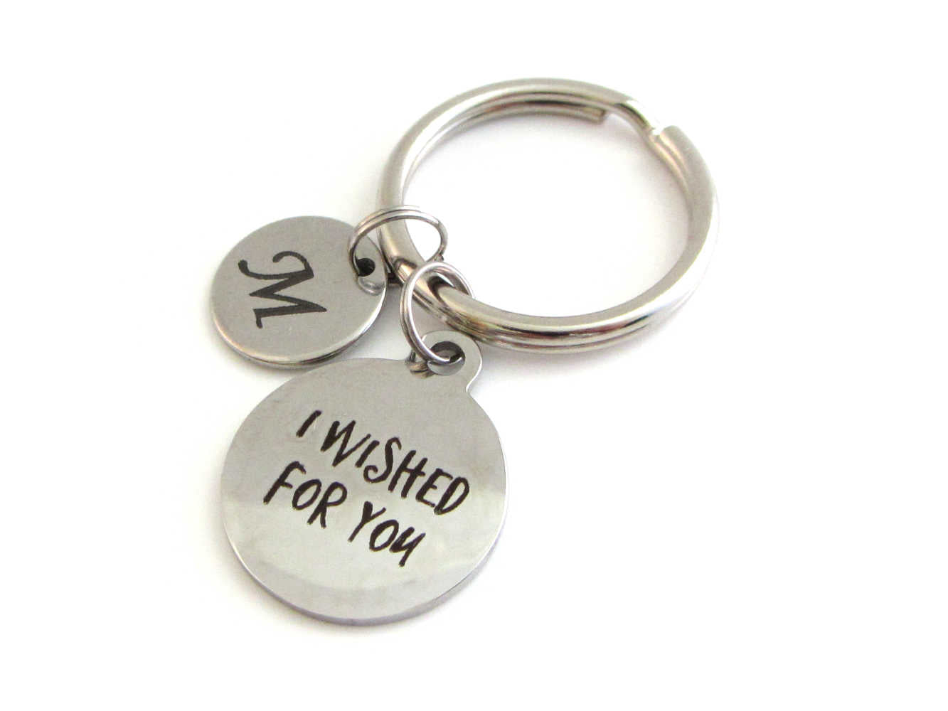 "laser engraved capital initial letter disc charm and a laser engraved ""I wished for you"" charm on a keyring"