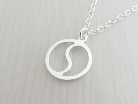 silver yin yang charm on a silver chain