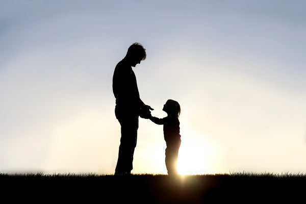 Happy Father's Day - Father with child against sunset
