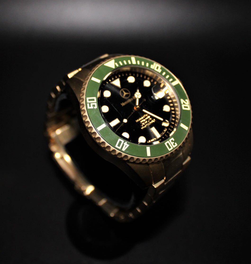 Automatic movement gold toned green bezel