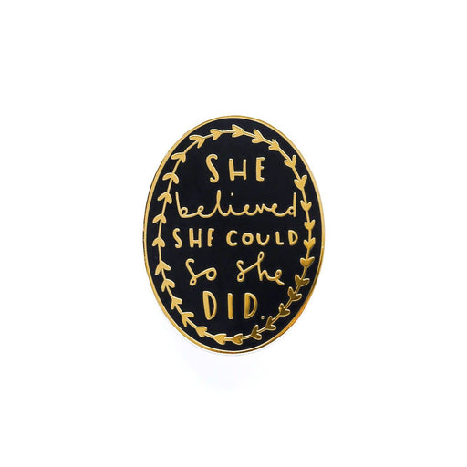 she believed black and gold enamel pin