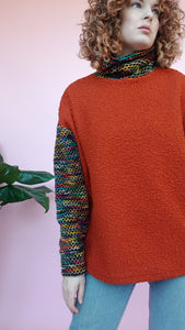 Bouclé Turtleneck Jumper with Rainbow Stripe Sleeves in Burnt Orange