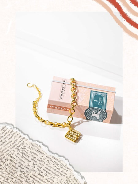 Our Mother of Pearl Book Bracelet will make sure your favorite reader has their favorite book handy at all times.