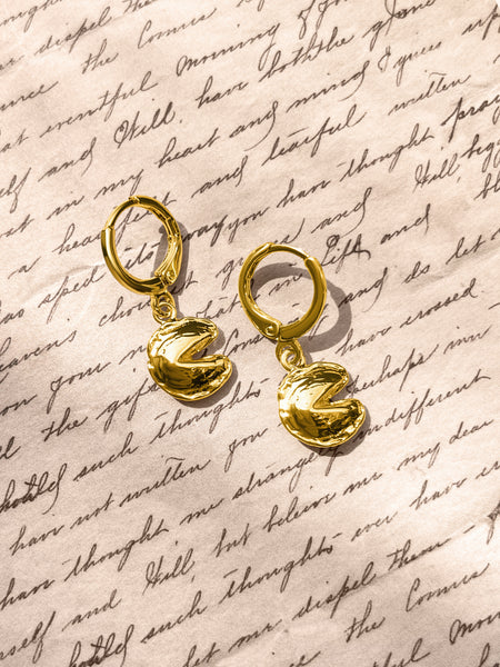 Gold Fortune & Frame Mini Fortune Cookie Earrings with a script font paper background.