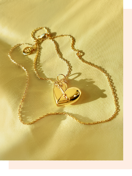 Shown here: Fortune & Frame Heart + Arrow Locket, a thoughtful gift for a female best friend.
