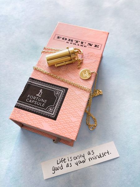 Shown here: Our Capsule + Wand Locket with an uplifting quote about new beginnings.