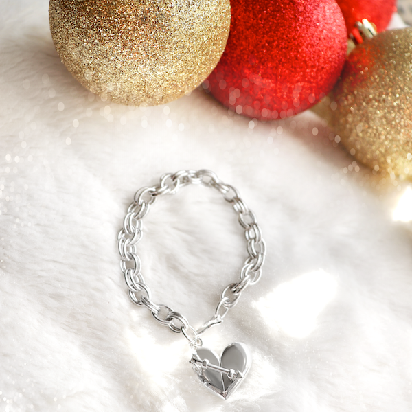 Shown here: Our Heart + Arrow Bracelet, a thoughtful Christmas gift to add a message inside