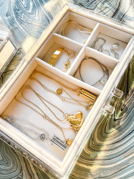 Shown here: a clear jewelry box storing Fortune & Frame jewelry.