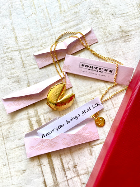 """Fortune & Frame Fortune Cookie Locket with the message, """"A new year brings good luck."""""""