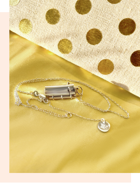 Shown here: Fortune & Frame Capsule + Wand Locket, a thoughtful gift to honor a female friendship.