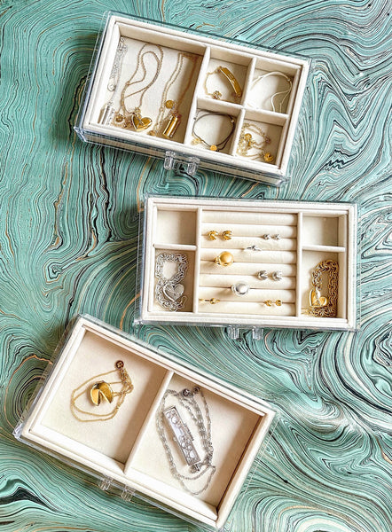 Jewelry storage solutions: organizing Fortune & Frame jewelry in separate compartments.