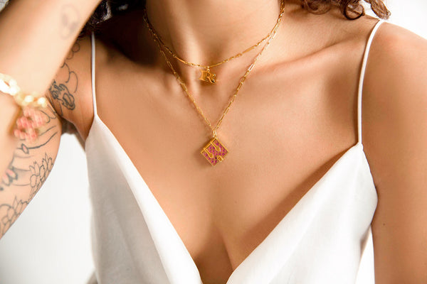 Woman wearing Fortune & Frame necklaces and bracelet for Mother's Day.