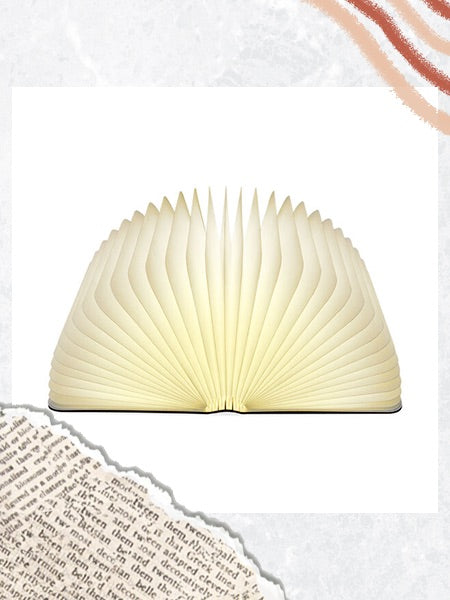 Image of the Lumio Book Lamp by MoMa Design Store on a collage background.