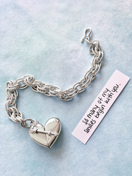 Shown here: Our Heart + Arrow Bracelet with an uplifting quote about new beginnings.
