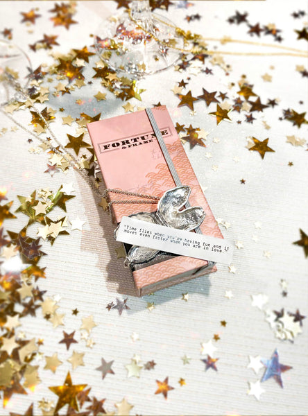 Shown here: Our Fortune & Frame Fortune Cookie Locket, an ideal traditional wedding anniversary gift for the years.